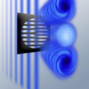 Soldan gelen düz dalga özel biçimlendirilmiş bir ağ ekranından geçiyor ardından bu dalga (elektron demeti) sağa ve sola dönen vortex demetlerine dönüşüyor.