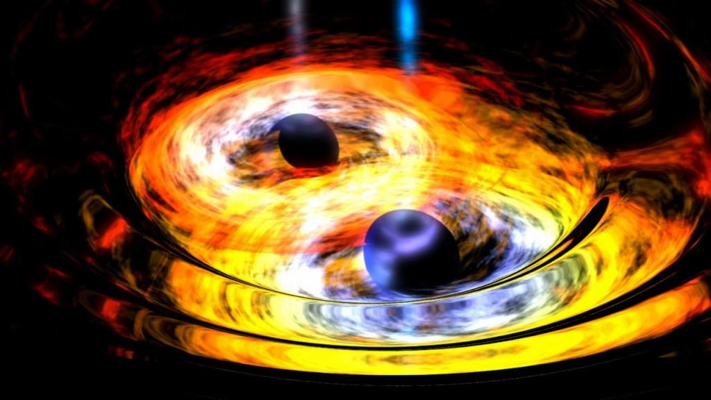 Bir gravitasyonel tangoda dolaşık iki karadeliğin temsil edilmesi. Galaksilerin kalbinde süperkütleli karadelikler daha küçük olanların birleştirilmesi yoluyla meydana geldiği düşünülmektedir. Image Credit: NASA