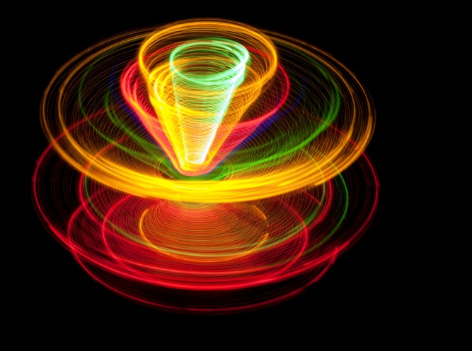 colorful lights spinning around a central axis