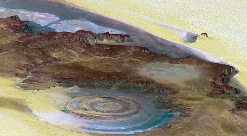 Landsat uydu görüntüsünde artırılmış renkler ile görüntülenen Sahra'nın Gözü. Image credit: NASA/JPL/NIMA